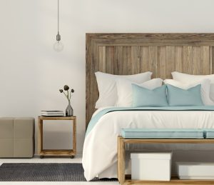 Minimal wood bedframe in bedroom showing an element of Japandi Design